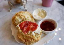 Homemade buttermilk scone with clotted cream and fresh confiture.